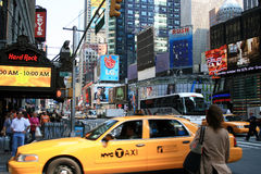 New York City. Downtown New York City street scene with taxis and bus on Broadway and 43rd in Times Square royalty free stock photo