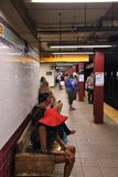 New York City. NEW YORK, USA - JULY 5, 2013: People wait at Canal Street subway station in New York. With 1.67 billion annual rides, New York City Subway is the stock photos