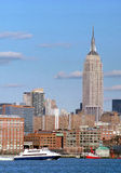 New York City USA. Empire State Building overlooks Hudson River harbor of Manhattan stock photos