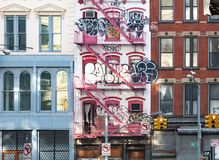 New York City, 2018: Abandoned building along Canal Street. Is covered with graffiti in Manhattan, New York City NYC royalty free stock photography