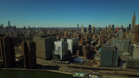New York City Aerial. V52 Flying over East River panning left with Manhattan cityscapes stock video footage