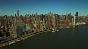 New York City Aerial. V55 Flying over East River panning right with view of Midtown Manhattan cityscape stock video footage
