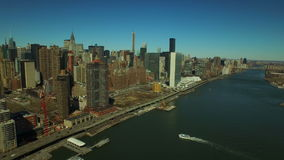 New York City Aerial. V53 Flying over East River towards Midtown East Manhattan stock video footage