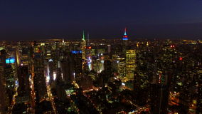 New York City Aerial. V25 Flying over Midtown Manhattan area toward Times Square at night stock footage