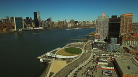 New York City Aerial. V62 Low flying backwards over Hunters Point panning left with views of Long Island City and Manhattan cityscapes. 3/12/15 stock video footage