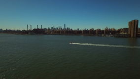 New York City Aerial. V49 Low flying over East River towards Stuyvesant Town stock footage