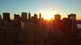 New York City Aerial. V39 Low flying panning left with view of Governors Island and Manhattan Financial District cityscape at sunrise stock video footage