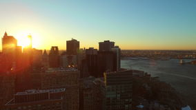 New York City Aerial. V40 Low flying panning right with view of Manhattan Financial District cityscape and Governors Island at sunrise stock video