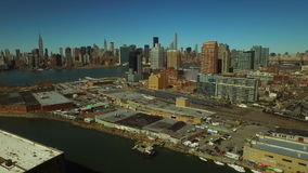 New York City Aerial. V61 Low flying towards Hunters Point and Midtown Manhattan with cityscape views. 3/12/15 stock video