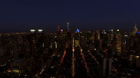 New York City Aerial. V23 Panning left with view of complete Manhattan cityscape at night/dusk stock video