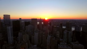 New York City Aerial. V36 Panning left with view of Manhattan Financial District cityscape at sunrise stock video footage