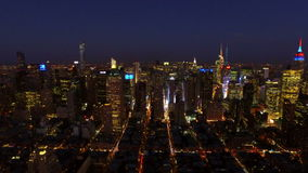 New York City Aerial. V26 Panning left with view of Midtown Manhattan cityscape at night/dusk stock video footage