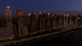New York City Aerial. V22 Panning left with view of west side and Lincoln Square area cityscapes at dusk stock footage