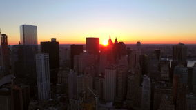 New York City Aerial. V38 Panning right and lowering with view of Manhattan Financial District cityscape at sunrise stock footage