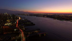 New York City Aerial. V24 Panning right with view of Manhattan and New Jersey cityscapes at dusk stock video footage