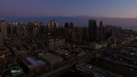 New York City Aerial. V19 Panning right with view of Manhattan and New Jersey cityscapes at dusk stock footage