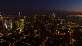 New York City Aerial. V27 Panning right with view of Manhattan and New Jersey cityscapes at night/dusk stock video