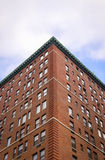 New York City apartment block. Low angle view looking up at the corner of a typical Manhattan apartment block stock photos