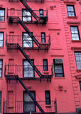 New York City Apartment Buildings. Fire escapes run diagonally down colorful apartment buildings in Greenwich Village, NYC Stock Photography