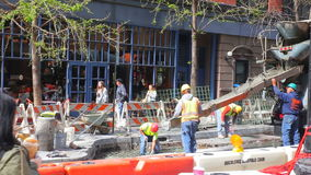 NEW YORK CITY - APRIL 20, 2016: Construction workers lay down cement in 42st - non-stop improvement happens in every