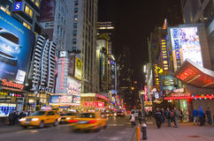 Times Square, New York. NEW YORK CITY - APRIL 19: Night scene of Times Square in Manhattan, New York City, with all the lit up billboards and advertisements, and stock photos