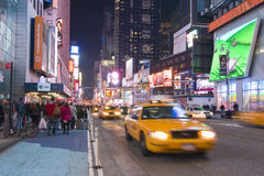 Times Square, New York. NEW YORK CITY - APRIL 19: Night scene of Times Square in Manhattan, New York City, with all the lit up billboards and advertisements, and stock images