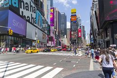 Broadway. Manhattan, New York. NEW YORK CITY - AUGUST 20, 2017: Manhattan, New York. Broadway at the intersection with West 45th street. Sunny summer day Royalty Free Stock Photo