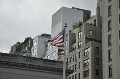 New York City,August 2nd:American Flag waving in the wind from Manhattan in New York City Royalty Free Stock Photography