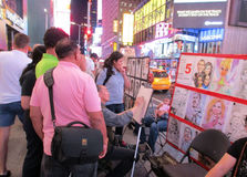 New York City,August 2nd:Artist in Times Square by night in Manhattan in New York City Stock Photos