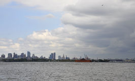 New York City,August 2nd:Brooklin from Hudson river on a dramatic sky from New York City stock photography