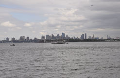 New York City,August 2nd:Brooklin from Hudson river on a dramatic sky from New York City royalty free stock image
