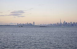 New York City,August 2nd:New Jersey City and Manhattan skyline at sunset over Hudson river. New Jersey City and Manhattan skyline at sunset over Hudson river on royalty free stock images