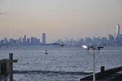 New York City,August 2nd:New Jersey City and Manhattan skyline at sunset over Hudson river Royalty Free Stock Photography