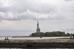 New York City,August 2nd:Statue of Liberty island on a dramatic sky in New York City Stock Photos