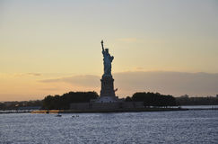 New York City,August 2nd:Statue of Liberty Island on sunset in New York City Stock Photos