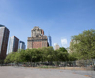 New York City, Battery Park area. Trees and Skyscrapers on a sun Royalty Free Stock Photo