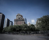 New York City, Battery Park area. Trees and Skyscrapers on a sun Royalty Free Stock Photography