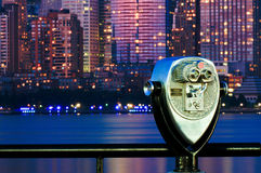 New York City binoculars. Classic binoculars or telescope at New Jersey central station, evening view of Hudson river and New York's Manhattan is seen in stock images
