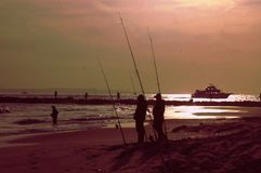 New york city breezy point fishing spot anglers evening. There is one of the populalar fishing area in New York city near Atlantic ocean , which is Breezy Point Royalty Free Stock Photos