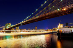 New York City Brooklyn bridge and Manhattan skyline night Hudson River Stock Images