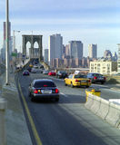 Brooklyn Bridge Traffic, New York USA. Afternoon traffic across the Brooklyn Bridge toward Manhattan royalty free stock photo