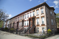 New York City brownstones in Bedford–Stuyvesant neighborhood in Brooklyn. NEW YORK - MAY 1: New York City brownstones in Bedford–Stuyvesant neighborhood in Royalty Free Stock Photos