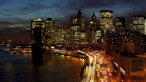 New York City. Busy traffic in New York City Manhattan with Brooklyn Bridge at dusk time lapse