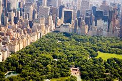New York City and Central Park. An aerial view of a corner of Central Park and the skyline of New York City stock images