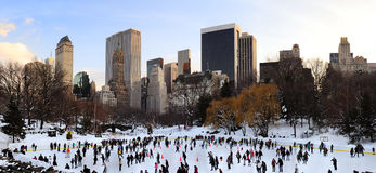 New York City Central Park ice skate. NEW YORK CITY, NY - JAN 1: People skate on ice with white Christmas in Central Park welcome the new year of 2010 on January Stock Images