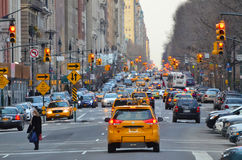New York City Central Park West. New York City, Central Park West, cars, taxis, people and red traffic lights royalty free stock image