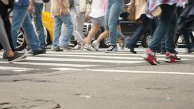 Slow Motion Low Angle Manhattan Crosswalk. 9439 NEW YORK CITY - Circa October, 2017 - A low angle slow motion view of people and traffic traveling over an stock footage