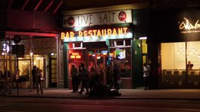 Night exterior establishing shot of Manhattan bar restaurant