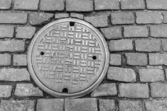 New York City Cobblestone Street and Manhole Cover Royalty Free Stock Photography