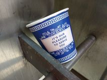 New York City Coffee Cup, NYC, NY, USA. Iconic New York City blue and white coffee cup with the phrase, It's Our Pleasure To Serve You. This photo was taken royalty free stock photography